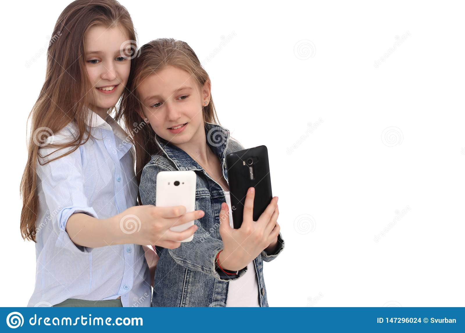 Portrait of two cheerful girls, girls take a selfie