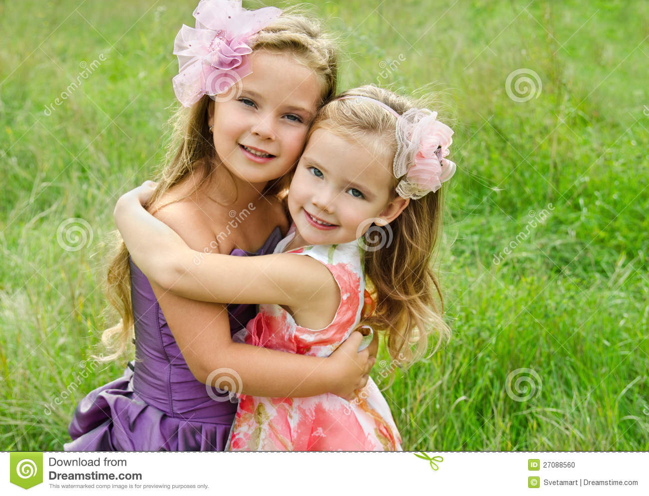 portrait of two embracing cute little girls stock photo - image of