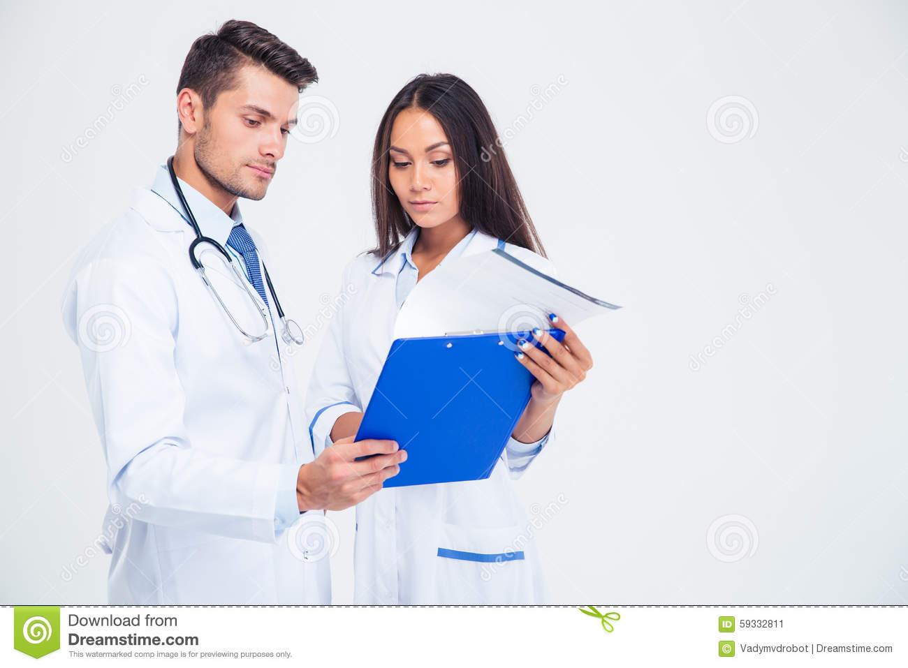 Portrait of a two medical workers looking at clipboard