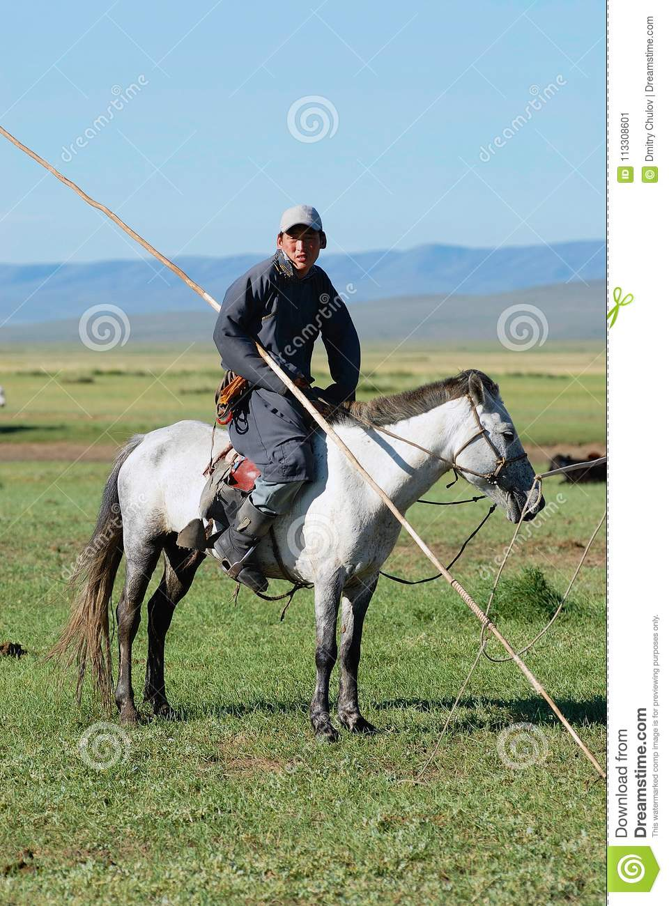 Download Portrait Of An Unidentified Mongolian Man Wearing Traditional Costume Riding On Horse Back In A & Portrait Of An Unidentified Mongolian Man Wearing Traditional ...
