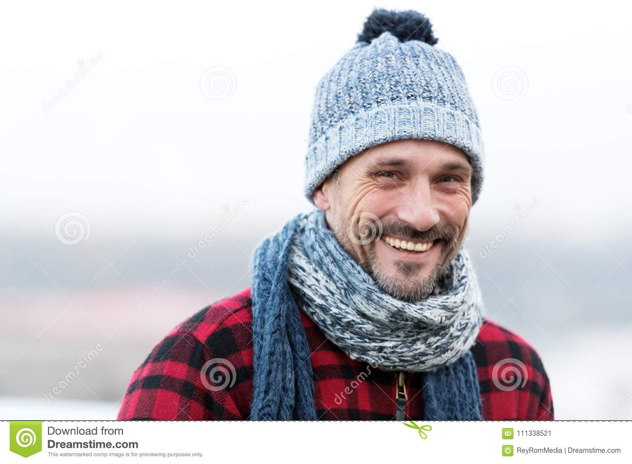 55ac8f572bb Portrait of urban smiling guy. Happy Man in hat with ball and scarf. Funny  guy smiles to you. Closeup of very smiling man face in winter clothes