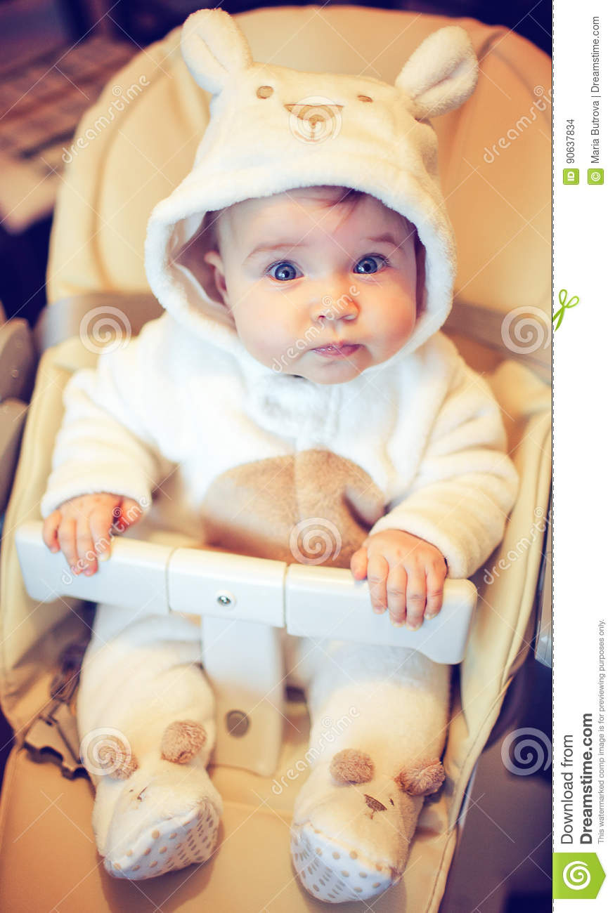 Portrait Of A Very Cute Baby Dressed As A Bear Stock Photo Image