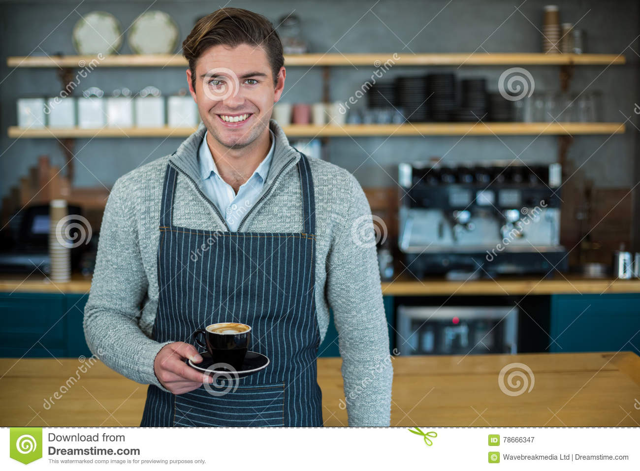 Exterior: Portrait Of Waiter Holding Cup Of Coffee Stock Image