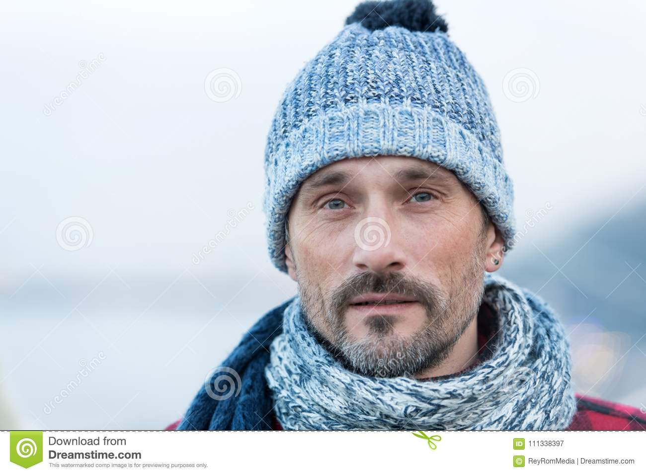 Portrait of white man in winter knitted hat and scarf. Close up of bearded  guy bf1e341d1c7