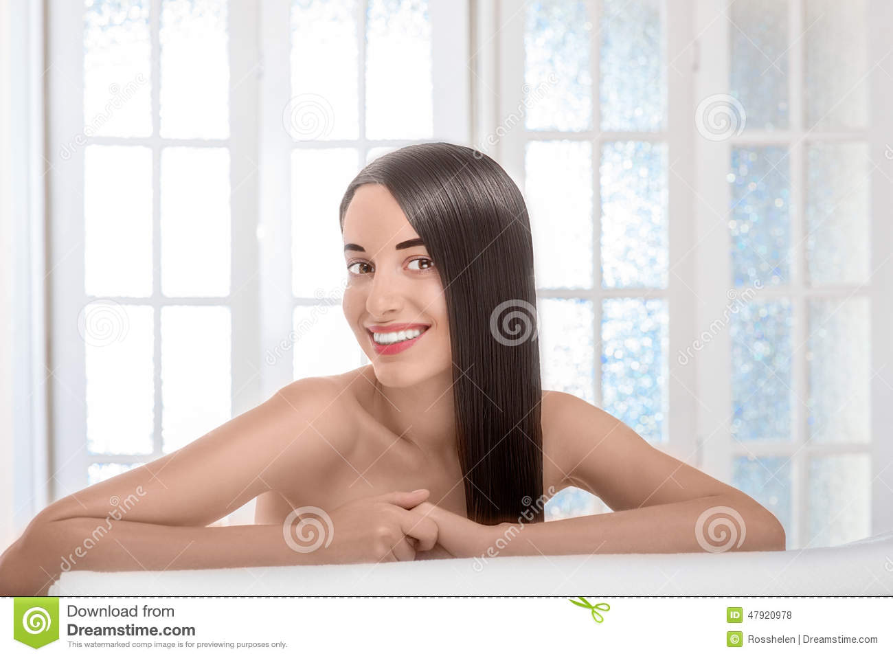 Portrait Of Woman With Beautiful Hair In Spa Salon Stock