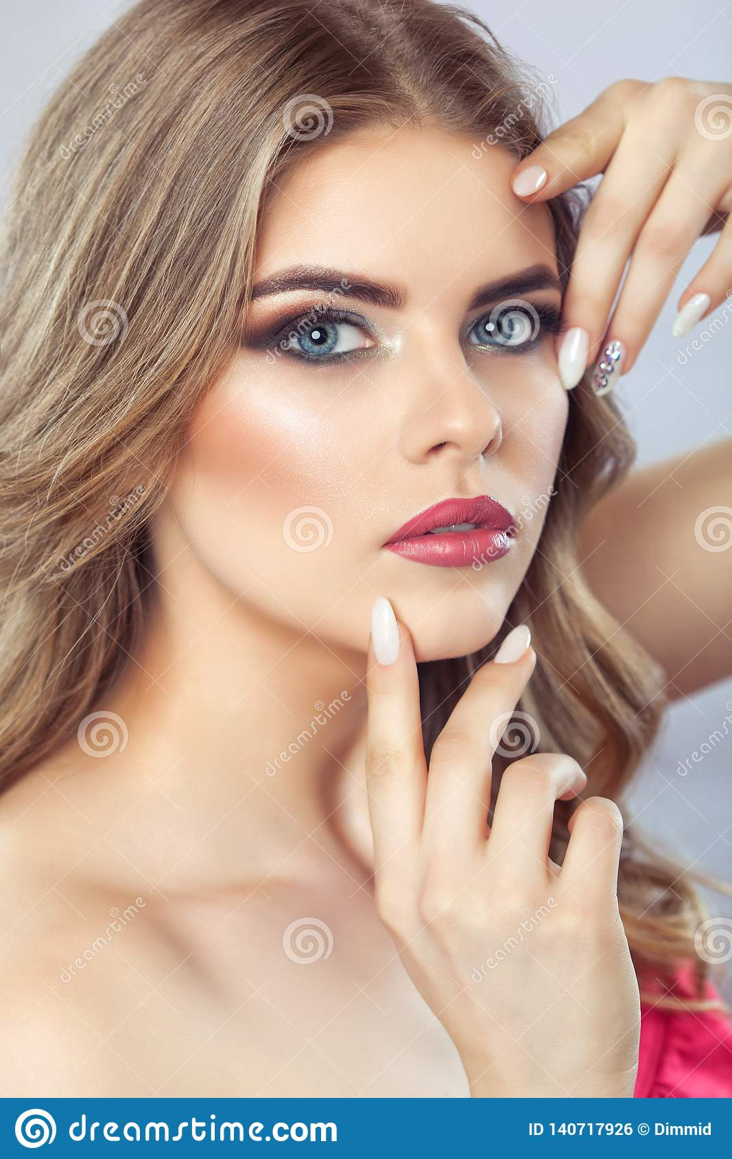 Portrait of a woman with beautiful make-up and manicure. Professional makeup and skin care