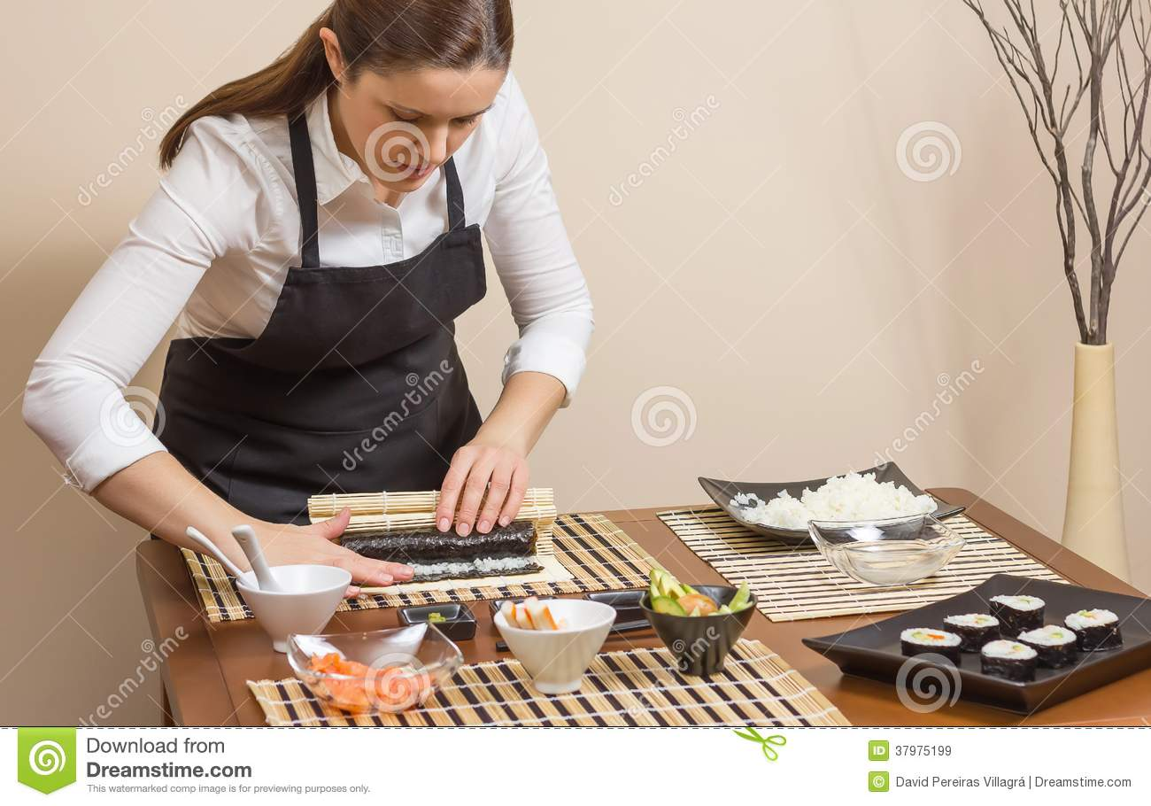 Portrait Of Woman Chef Rolling Up A Japanese Sushi Royalty