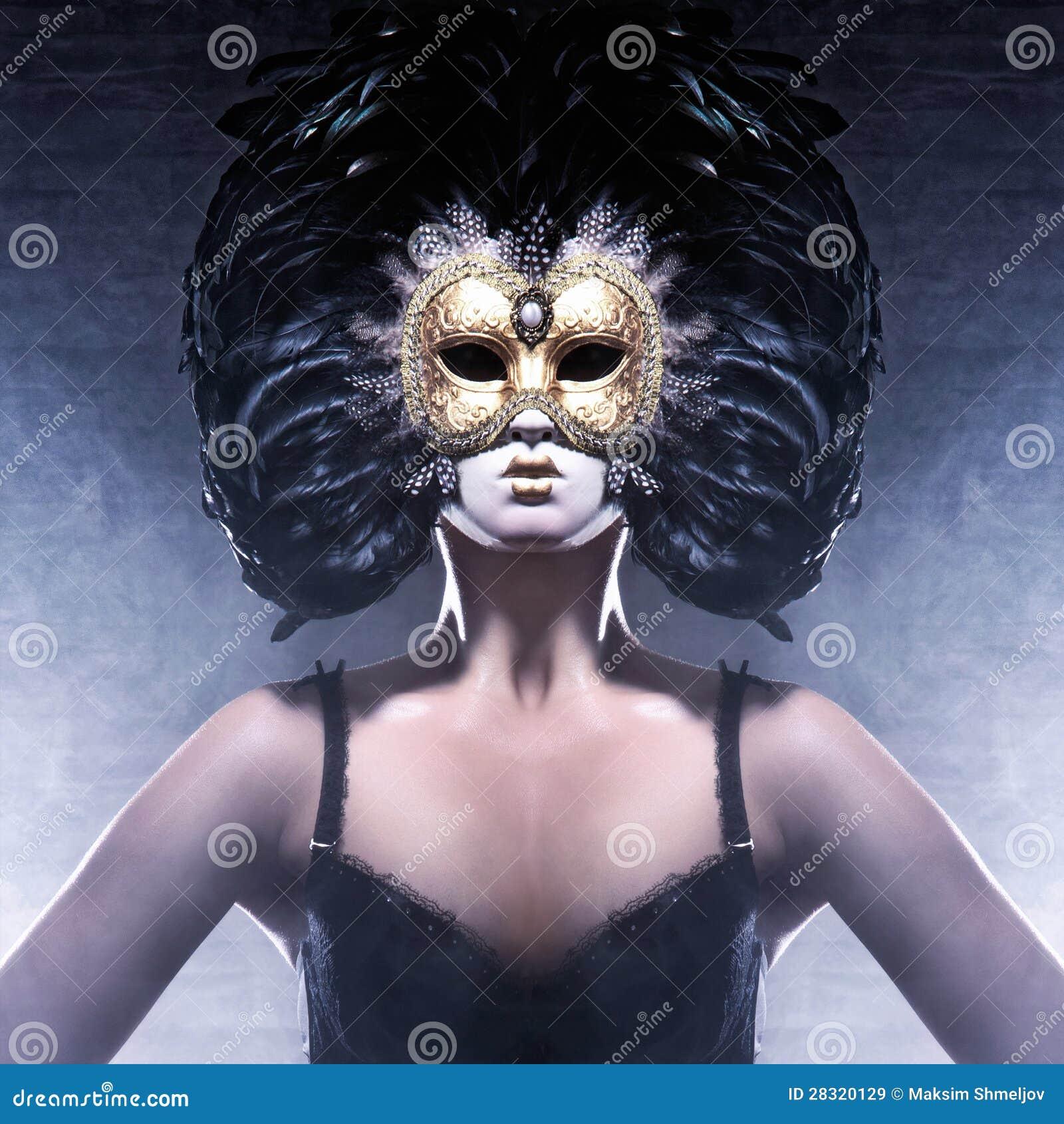 Portrait of a woman in a dark Venetian mask