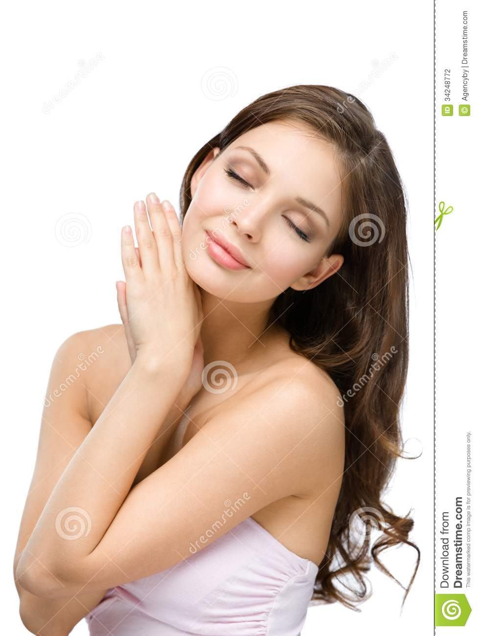 Portrait Of Woman With Eyes Closed Touching Face Stock
