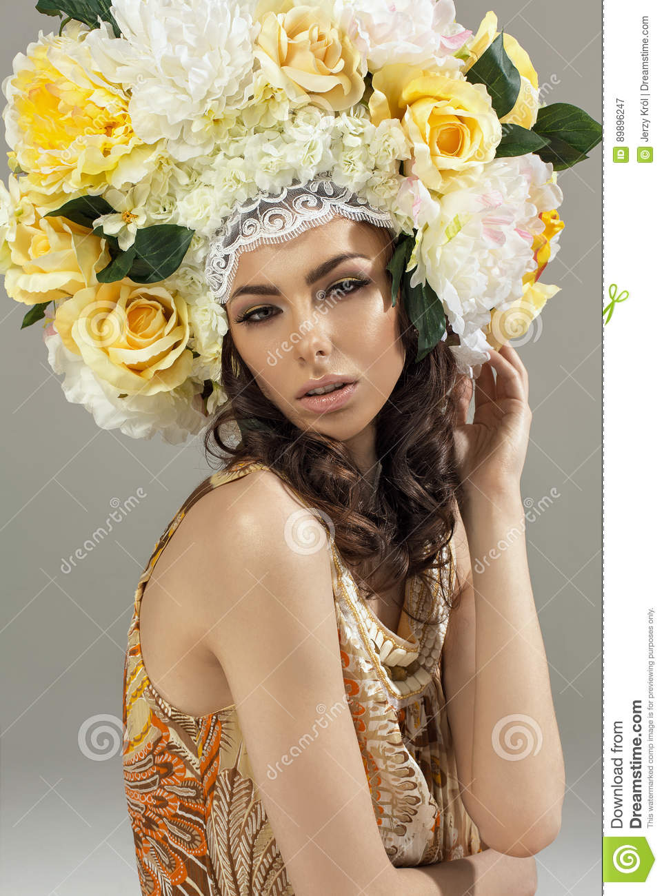 Portrait of woman with floral crown stock image image of girl a woman wearing a large headpiece with white and yellow flowers mightylinksfo