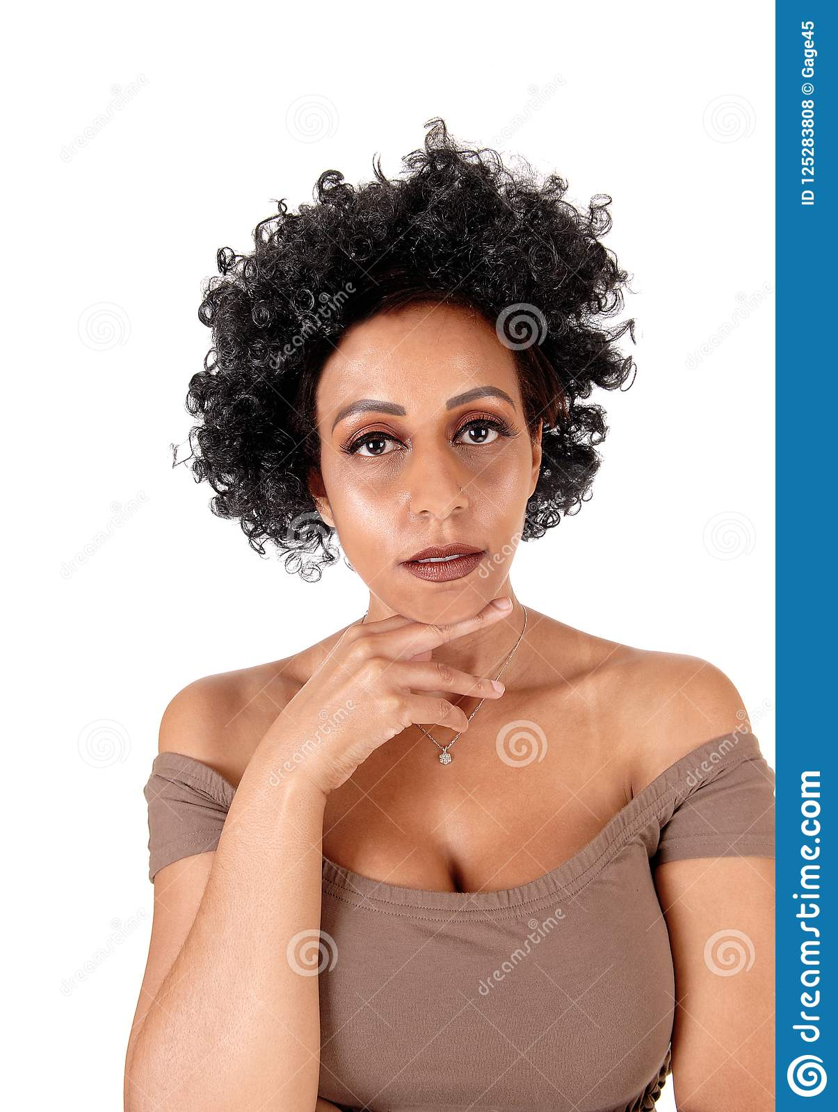 Portrait of woman with fussy black hair
