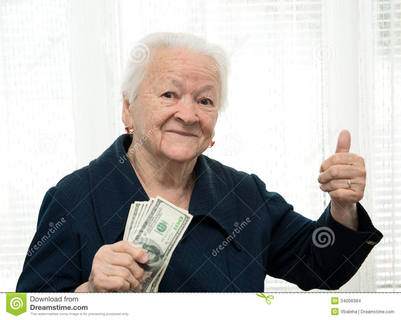 Portrait Of An Woman Holding Money In Hand And Showing Yes