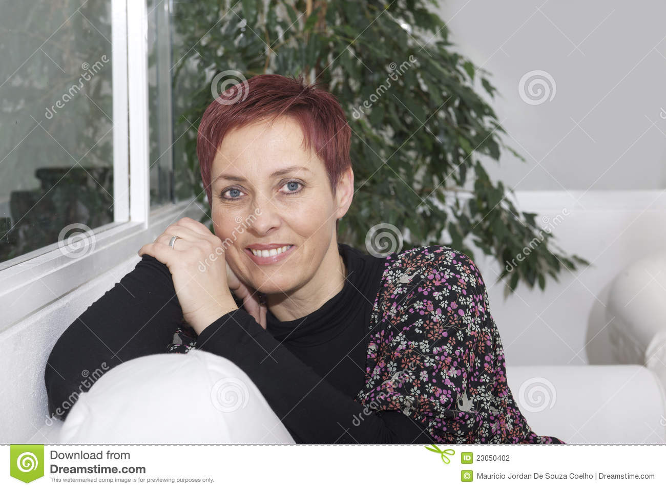 Stock photography portrait of woman in living room