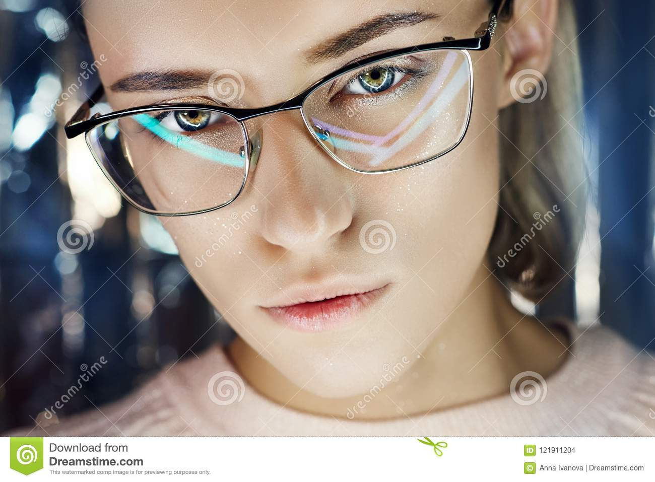 Portrait of a woman in neon colored reflection glasses in the background. Good vision, perfect makeup on girl face. Art portrait