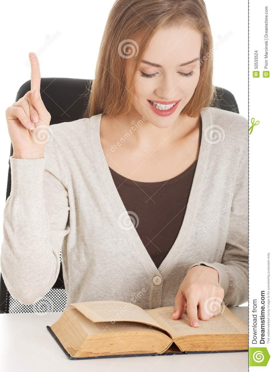 Portrait of a woman reading book