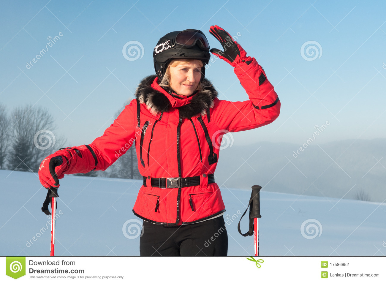 Portrait Of Woman Skier In Red Jacket Stock Photography