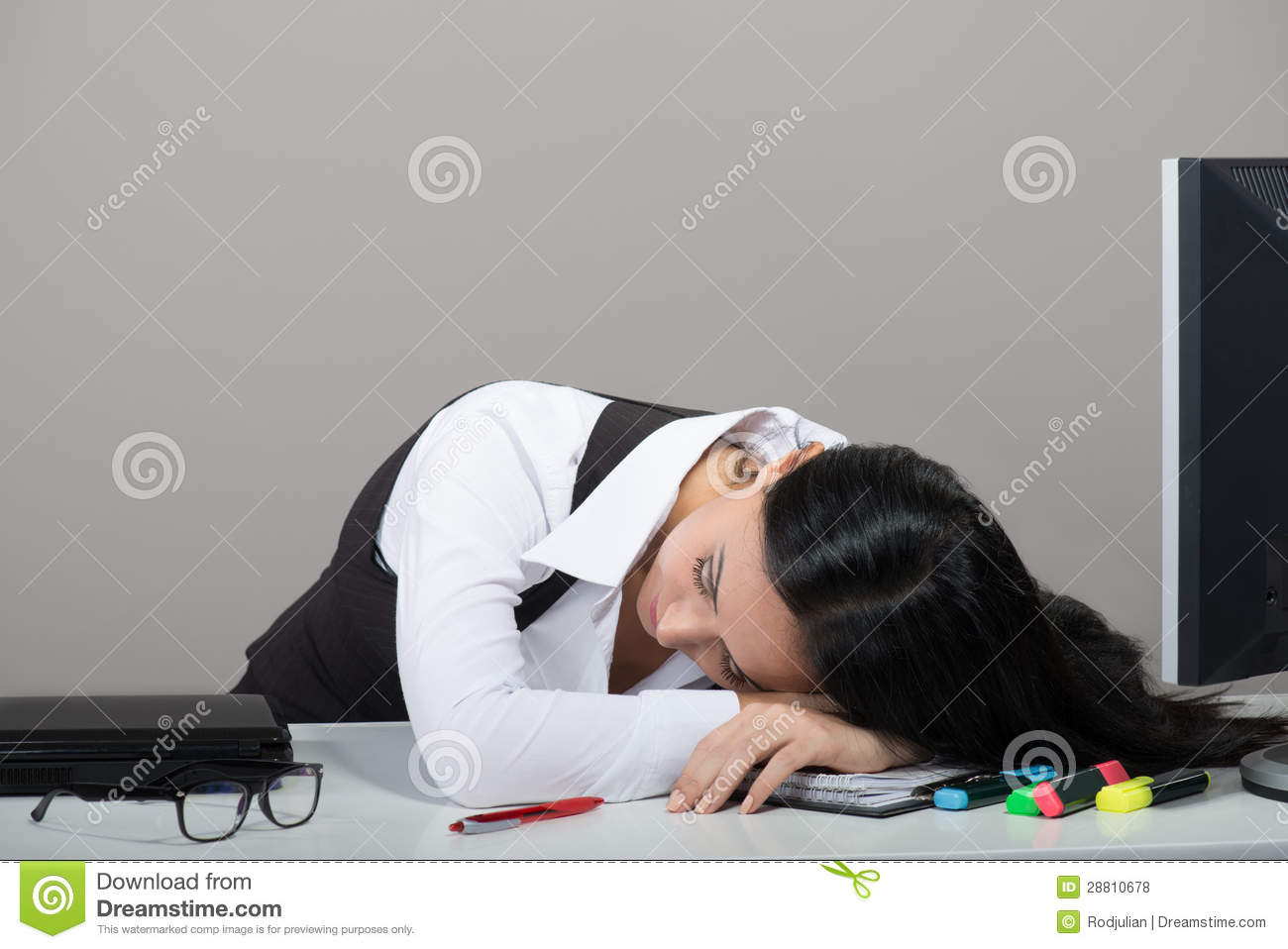 Portrait of woman sleeping on her workplace