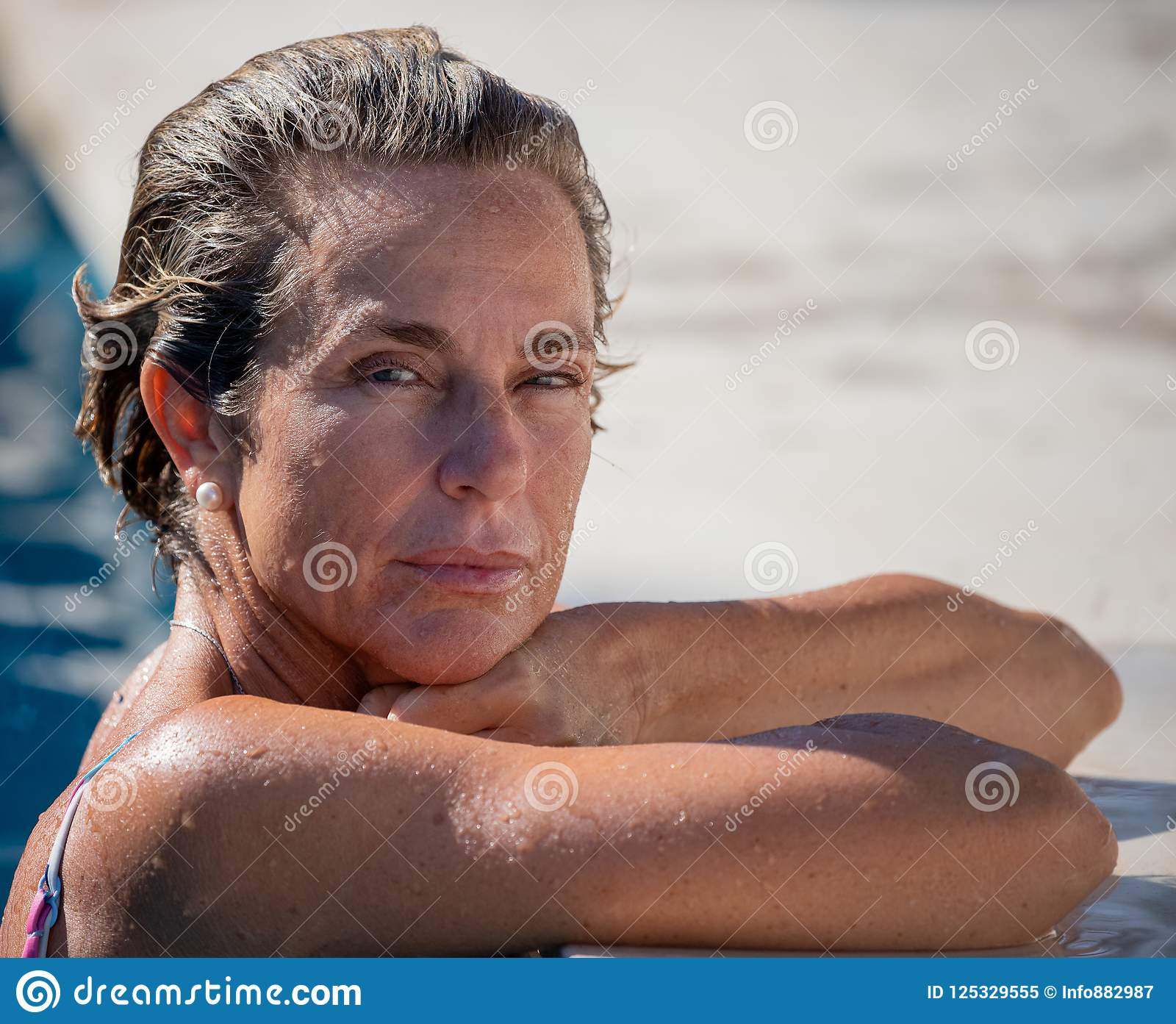 07481cfa646030 Portrait of a woman in a swimming pool during her holidays. More similar  stock images. Beach in March, Fuengirola, Spain ...