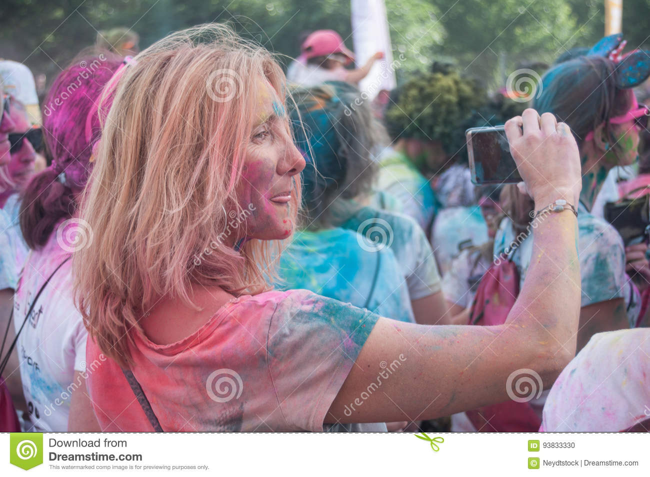 Portrait of woman taking a picture with phone at Colore Mulhouse 2017