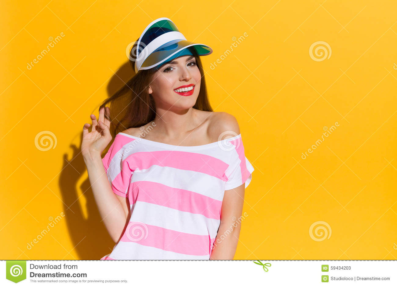 Portrait Of Woman In Transparent Plastic Blue Sun Visor Stock Image ... 43ffd4e44e9