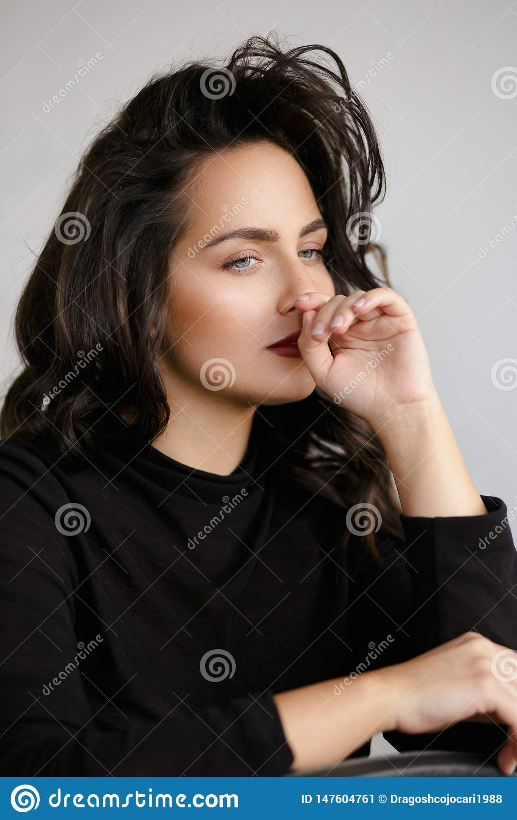 Beauty portrait of a young woman in black, isolated on a white backgorund.
