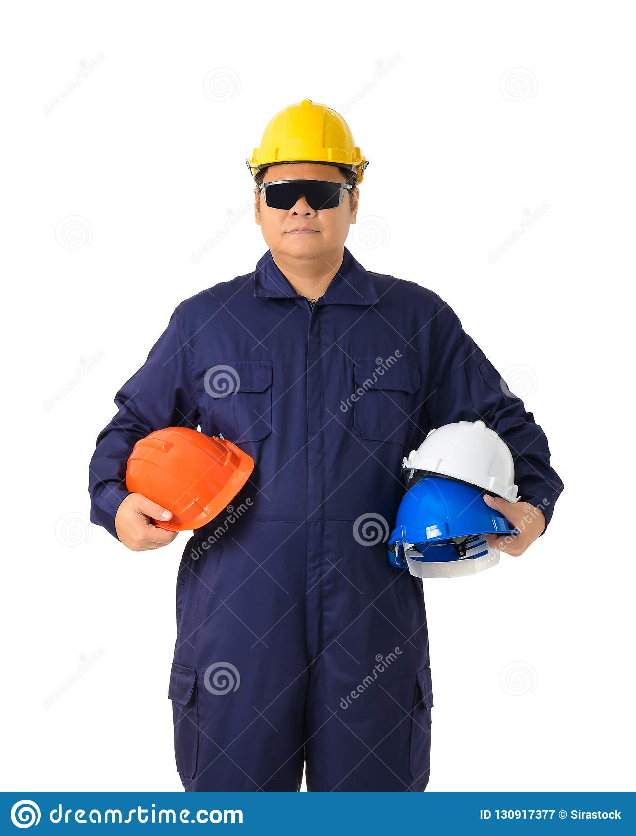 65b07d601b3 Portrait of a worker in Mechanic Jumpsuit holding helmet multicolor with Safety  goggles isolated on white background clipping path