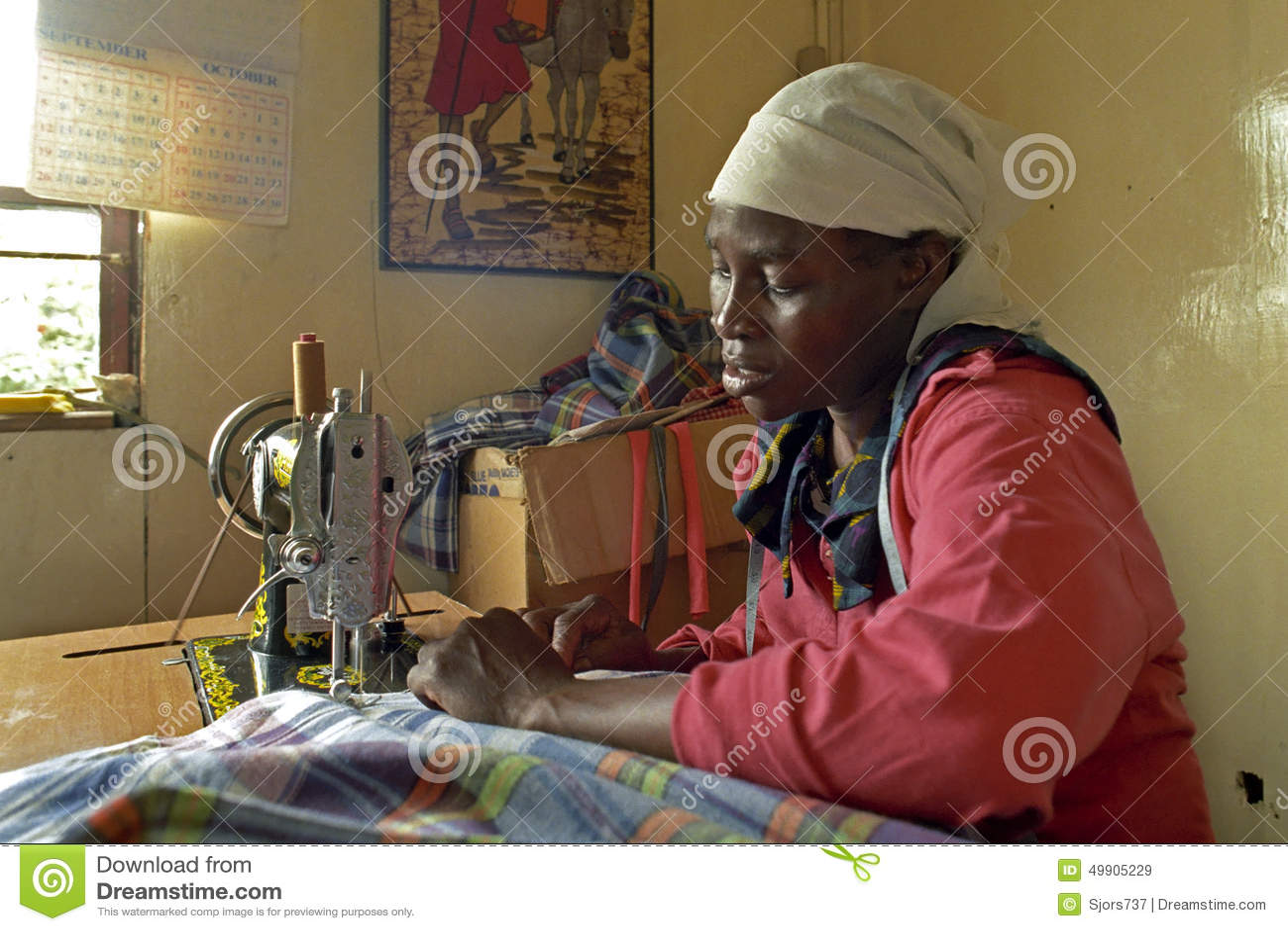 Portrait of working Kenyan woman in sewing room