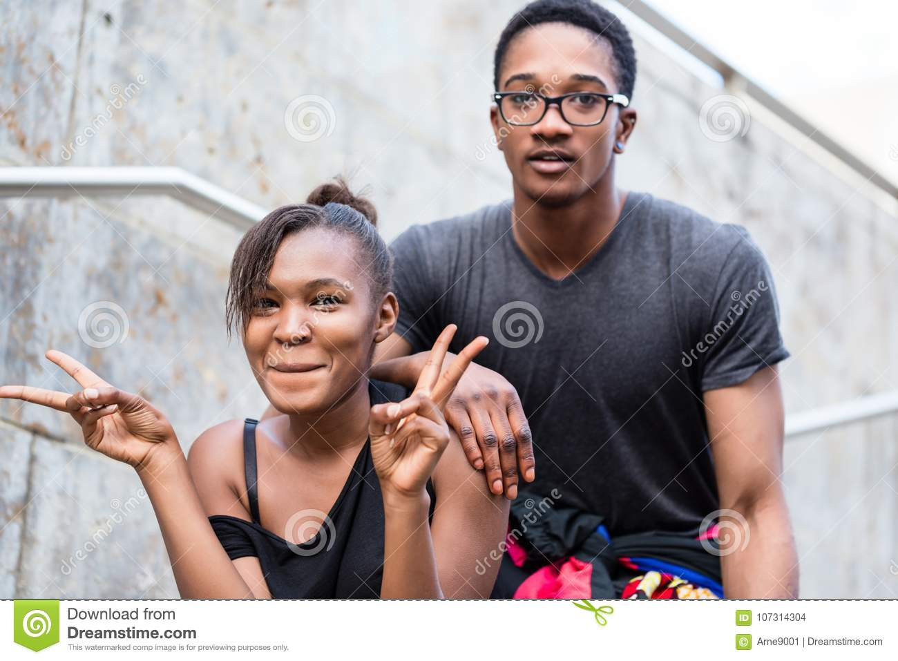 Portrait of young African American couple making funny faces whi