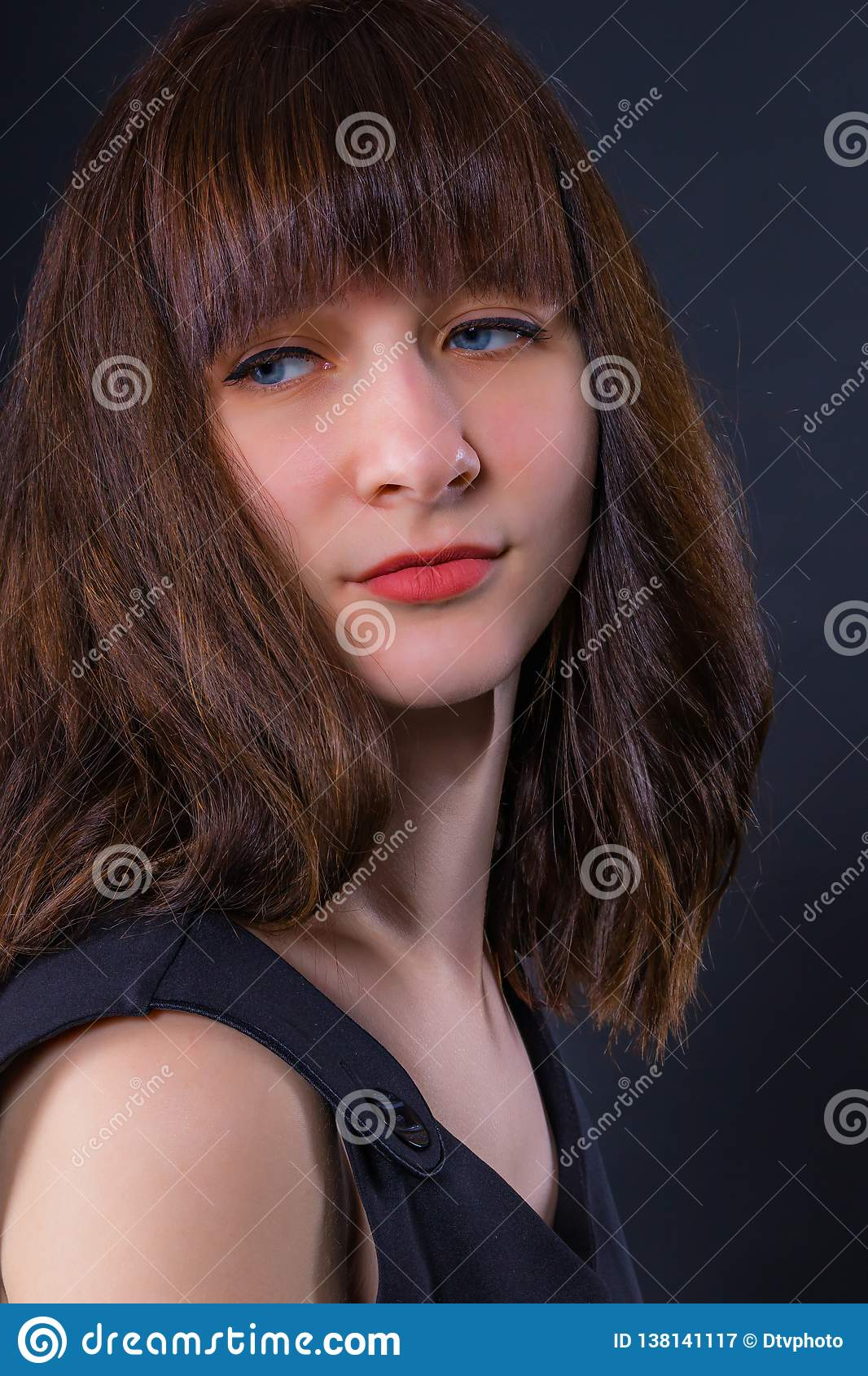 Portrait of a young attractive pensive girl