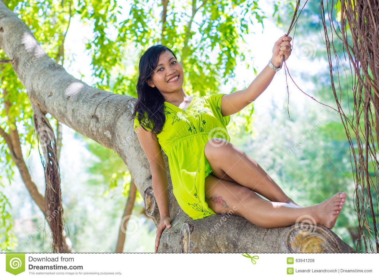 Rigorous Girl sitting on a tree important