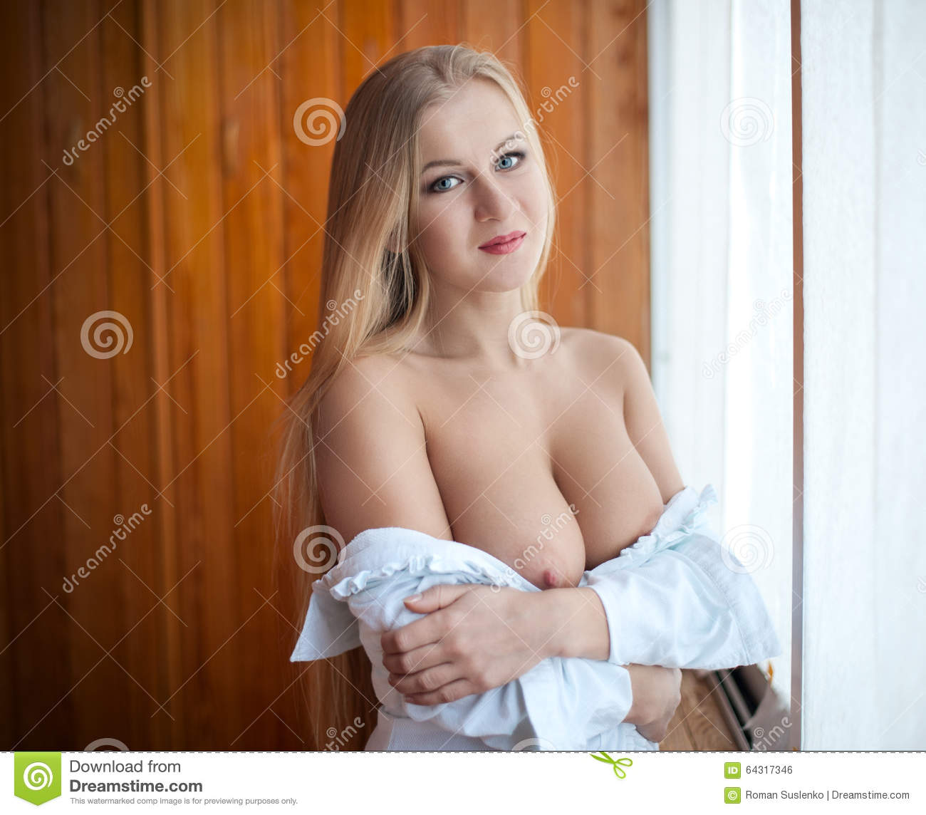 portrait of a young beautiful blonde with big naked breast stock