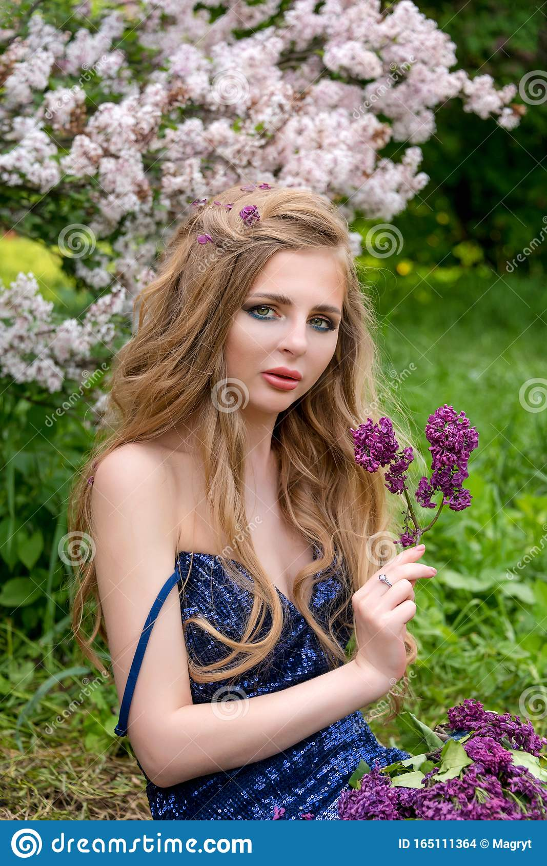 Beautiful Young Blonde Girl With Disheveled Hairstyle And