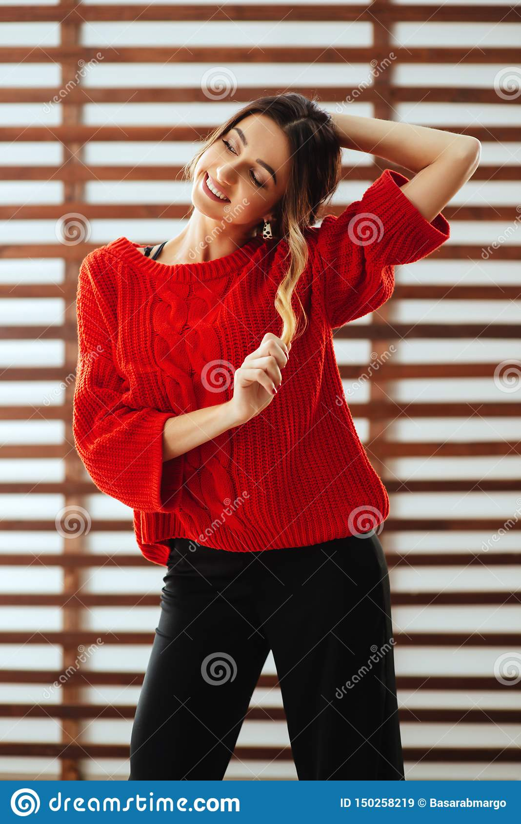 Portrait of young beautiful caucasian woman in red t-shirt