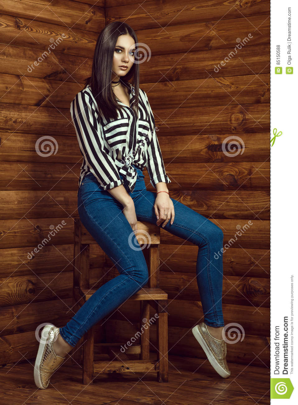 Portrait Of Young Dark-haired Model Wearing Skinny High