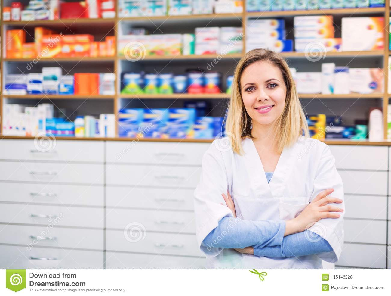 Portrait of a young friendly female pharmacist.