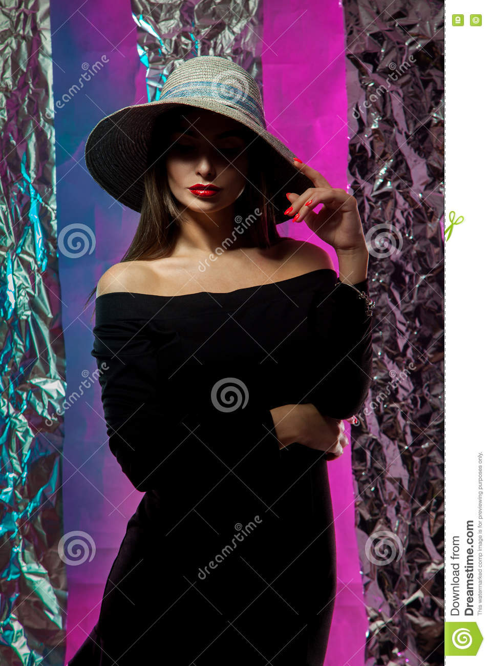 Portrait of young beautiful girl in hat with wide brim
