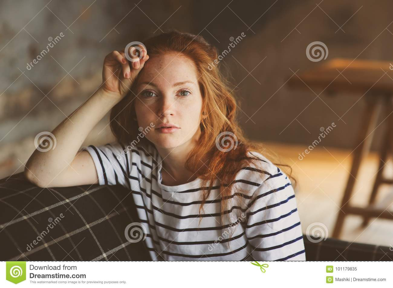 Portrait Of Young Beautiful Redhead Woman Relaxing At Home In The Autumn Ot Winter Cozy Evening
