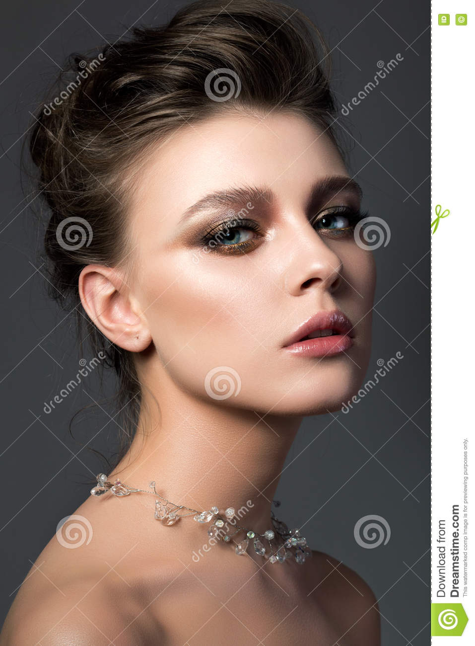 Portrait Of Young Beautiful Woman With Bridal Makeup And Coiffur