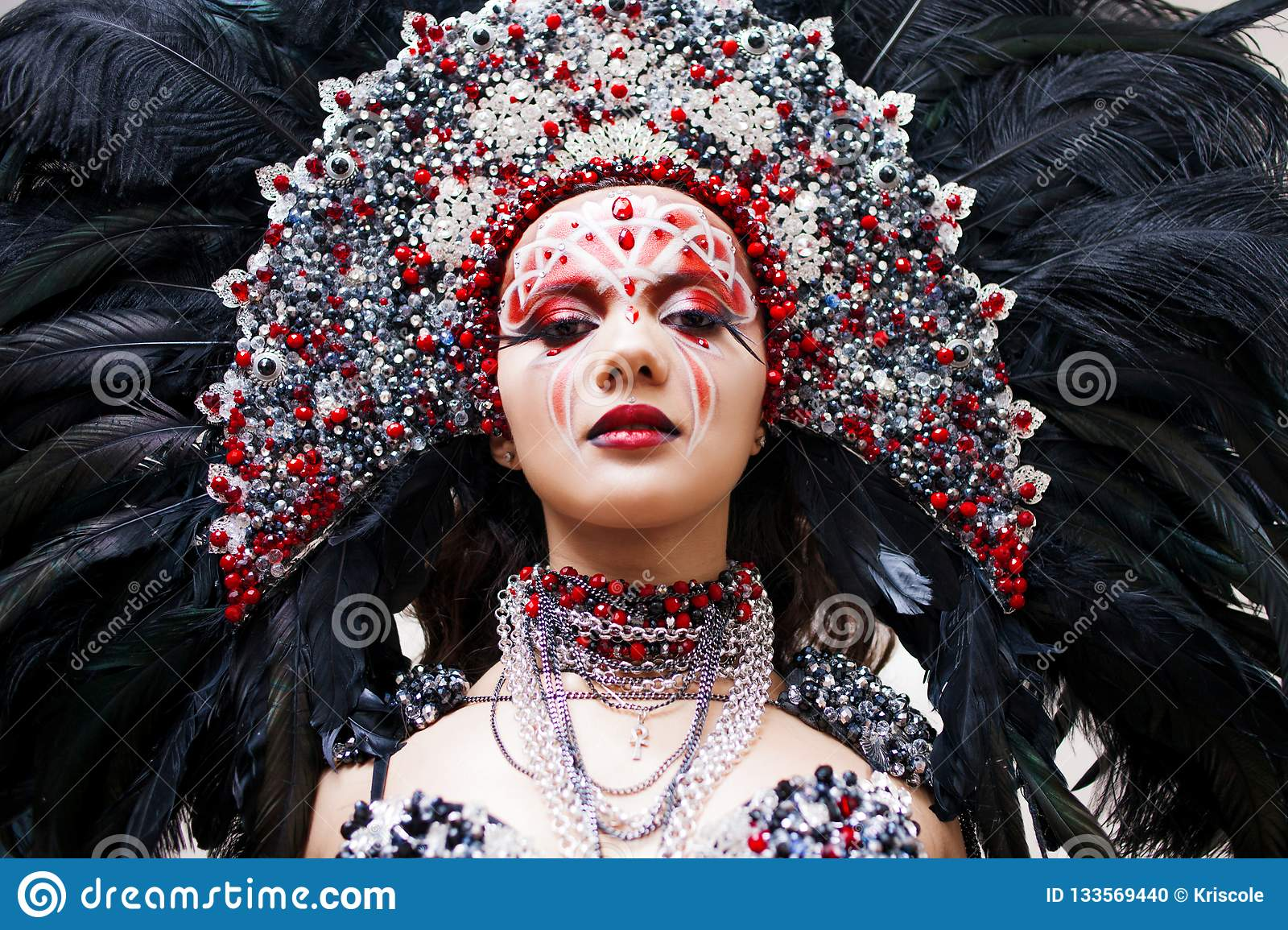 Portrait of a young beautiful woman in a creative look. The style of carnival and dancing.
