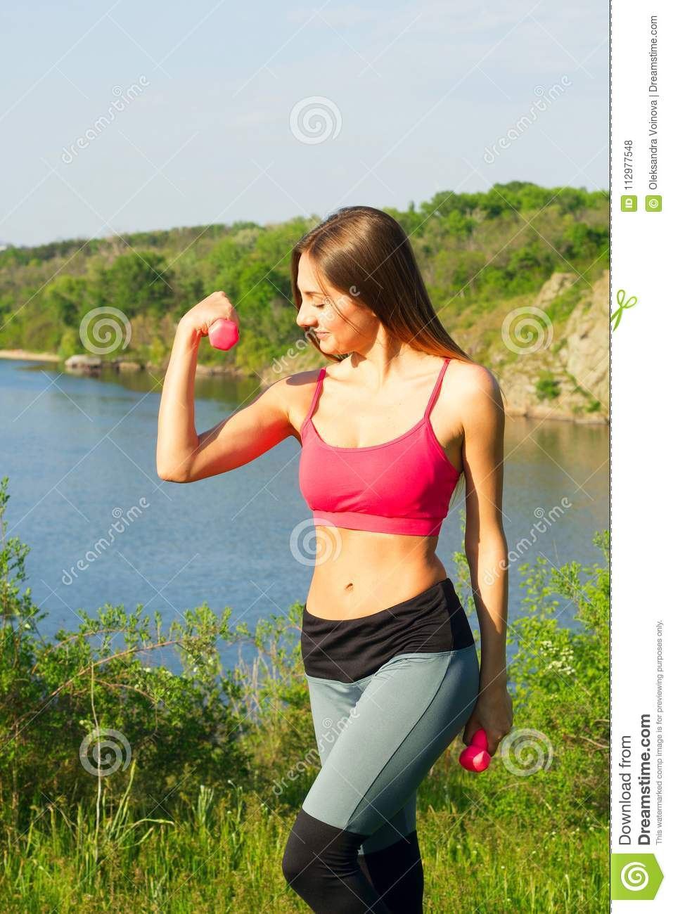 Portrait of young beautiful woman doing sport outside