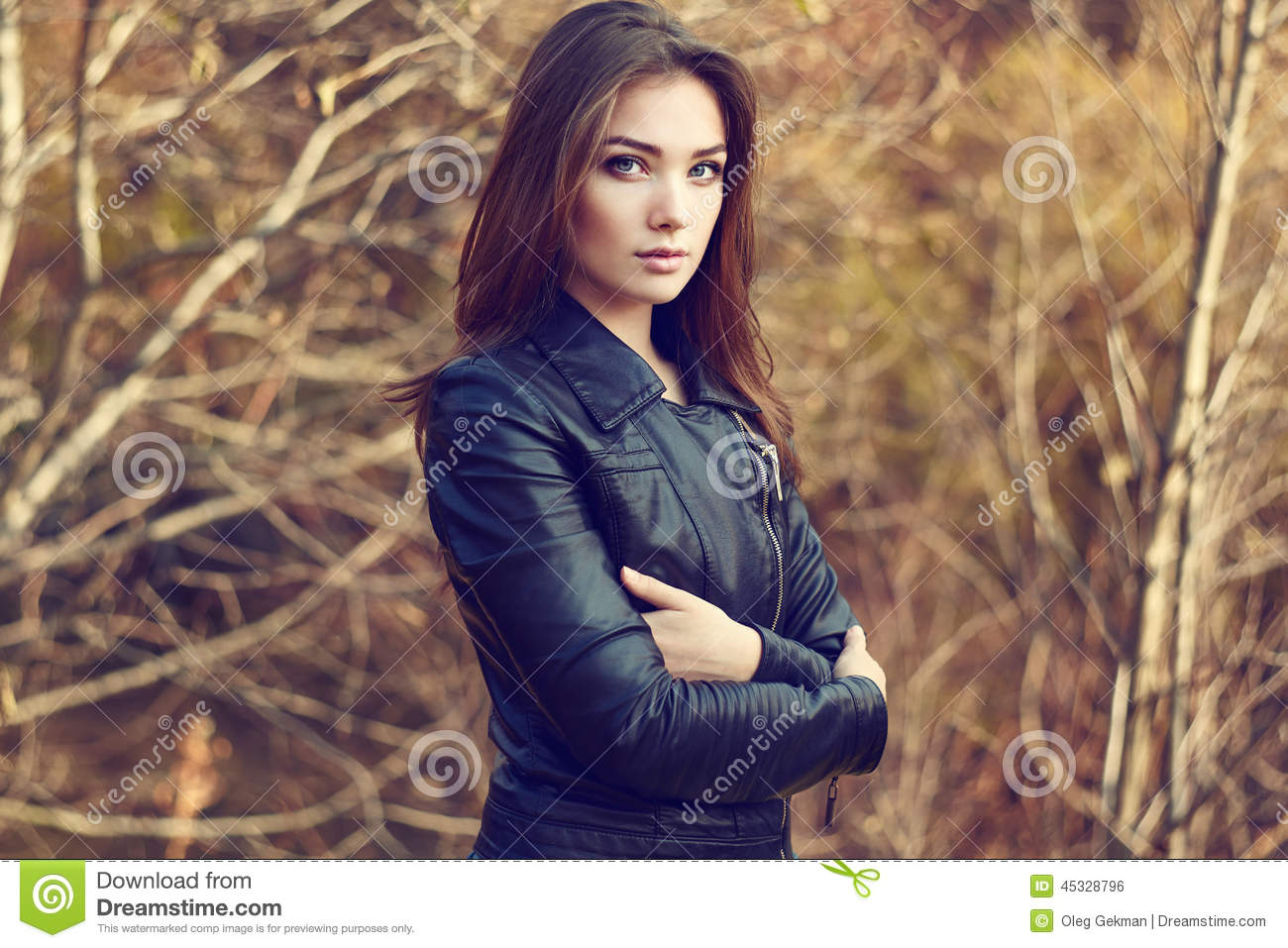 Portrait Of Young Beautiful Woman In Leather Jacket Stock