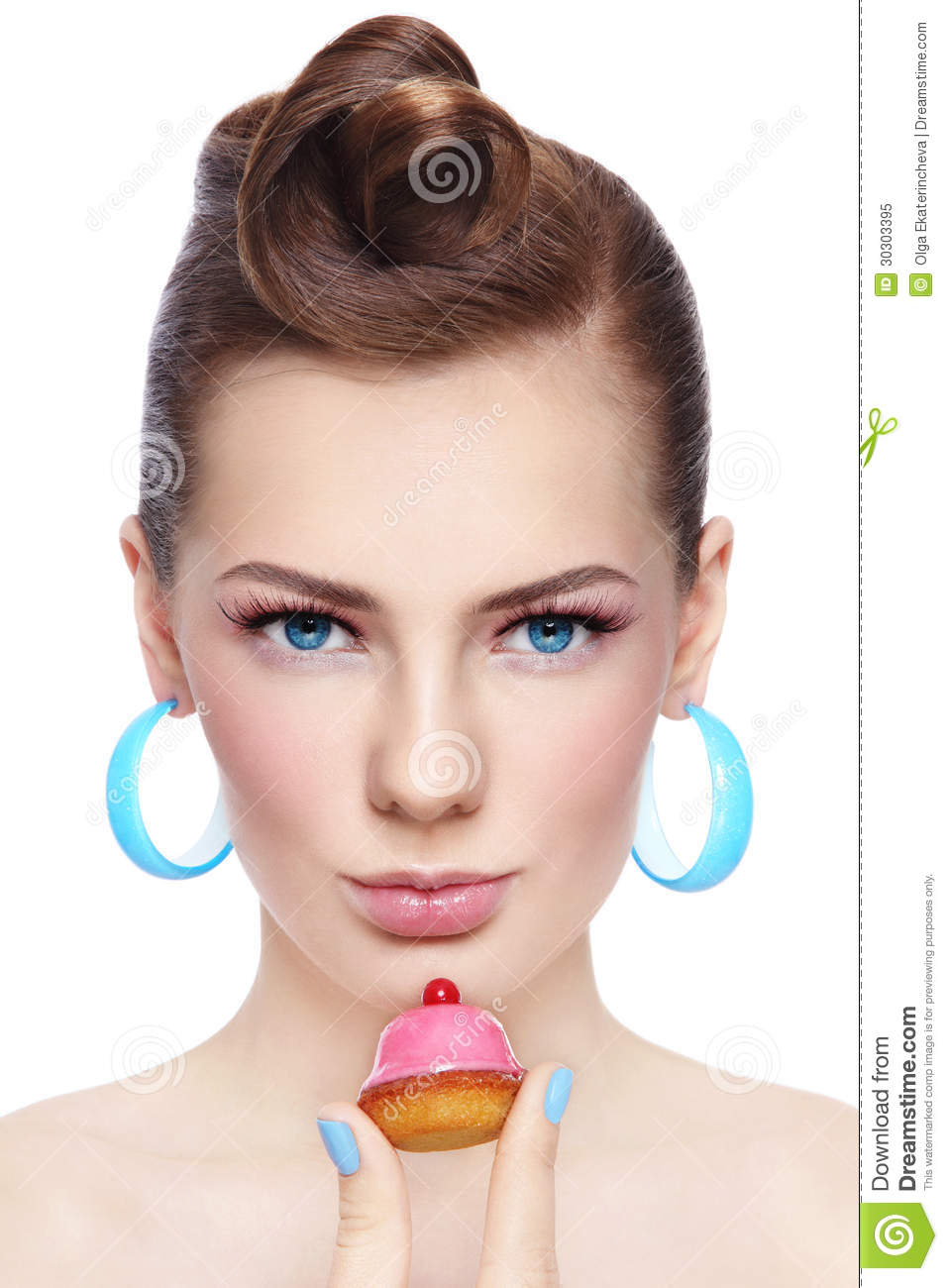 Portrait Of Young Beautiful Woman With Petit Four Pastry In Her Hand