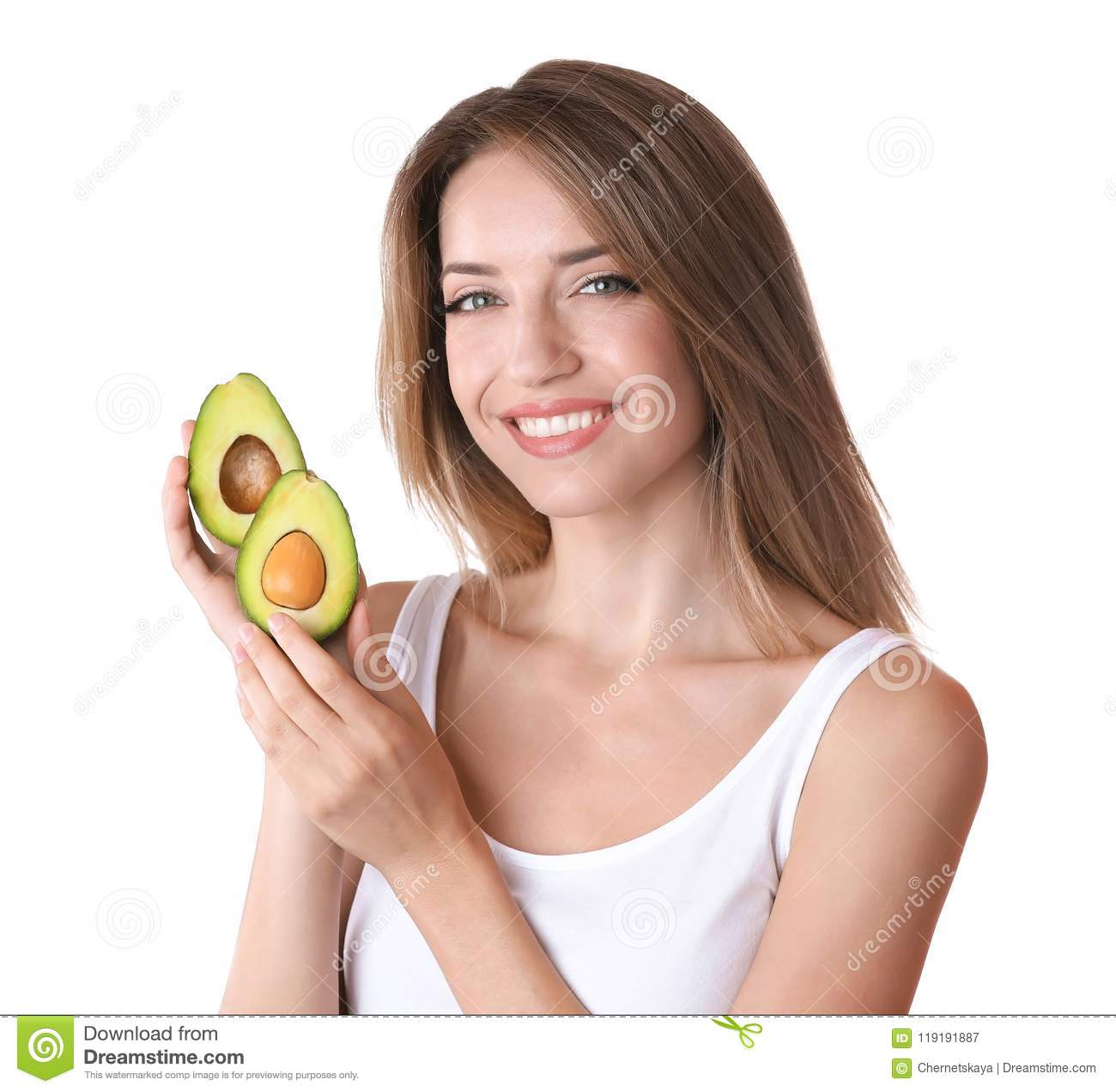Portrait of young beautiful woman with ripe avocado on white background