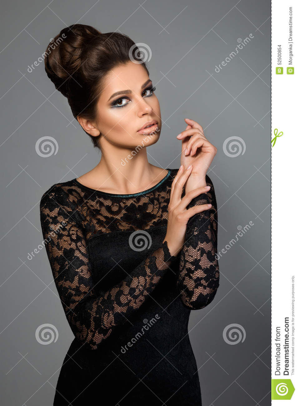 Black dress hairstyle - Portrait Of Young Beautiful Woman Wearing Black Dress Stock Photo