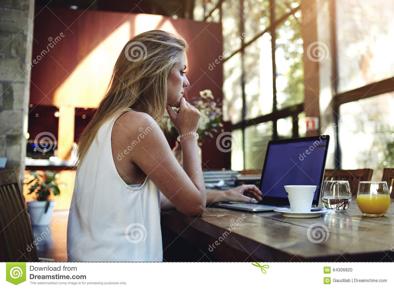 Portrait Of A Young Beautiful Woman Working