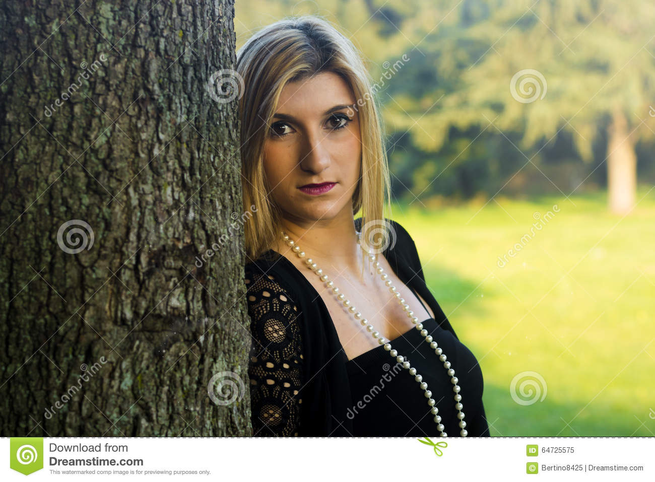 Portrait Of A Young Blonde Woman With Brown Eyes Stock