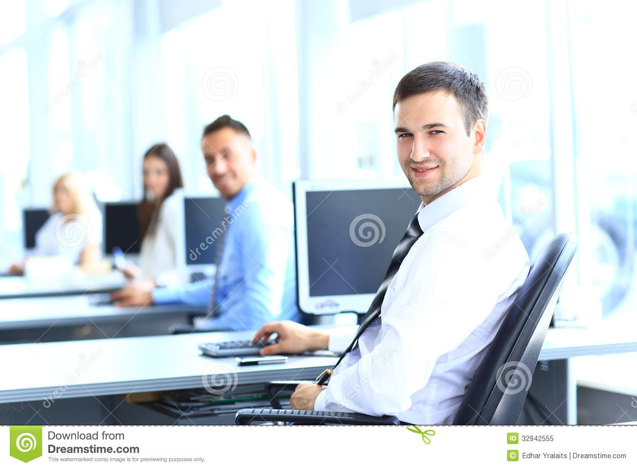 Portrait of young businessman in office with colleagues royalty free stock photo image 32942555 - Office portrait photography ...