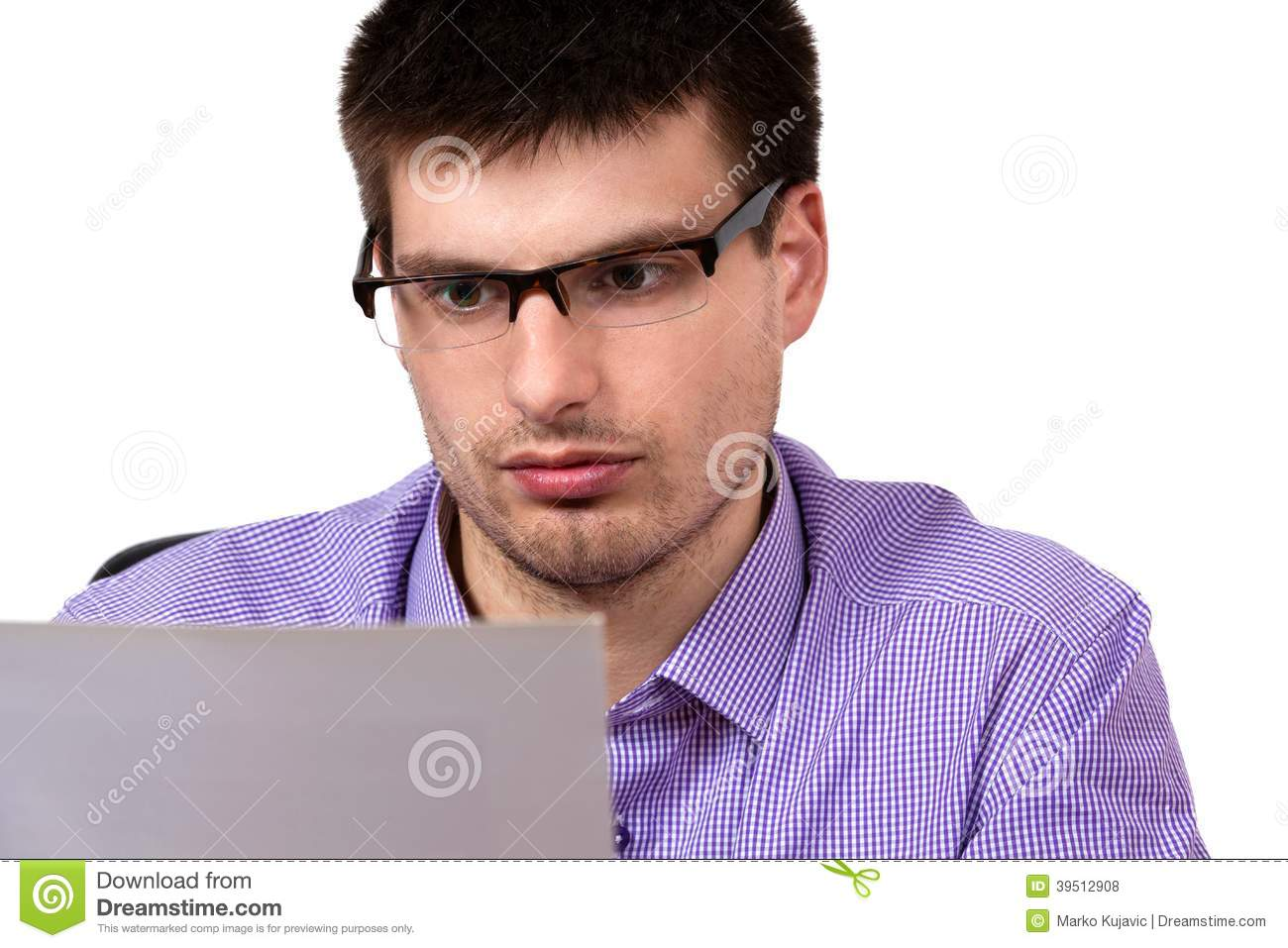 Portrait of young businessman, reading business document