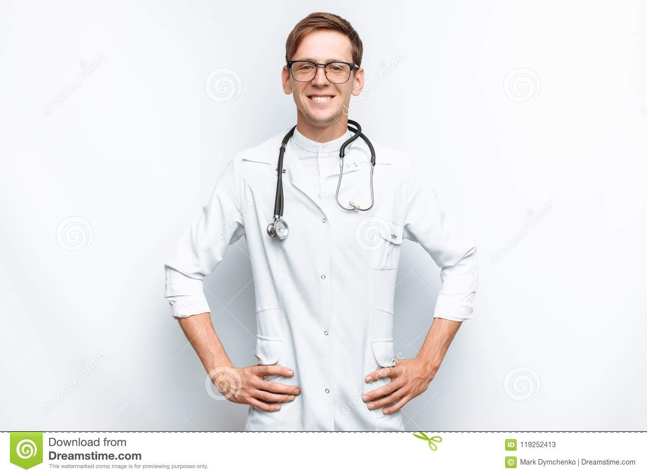 Portrait of a young doctor on a white background, Intern in the Studio, with a stethoscope on the neck