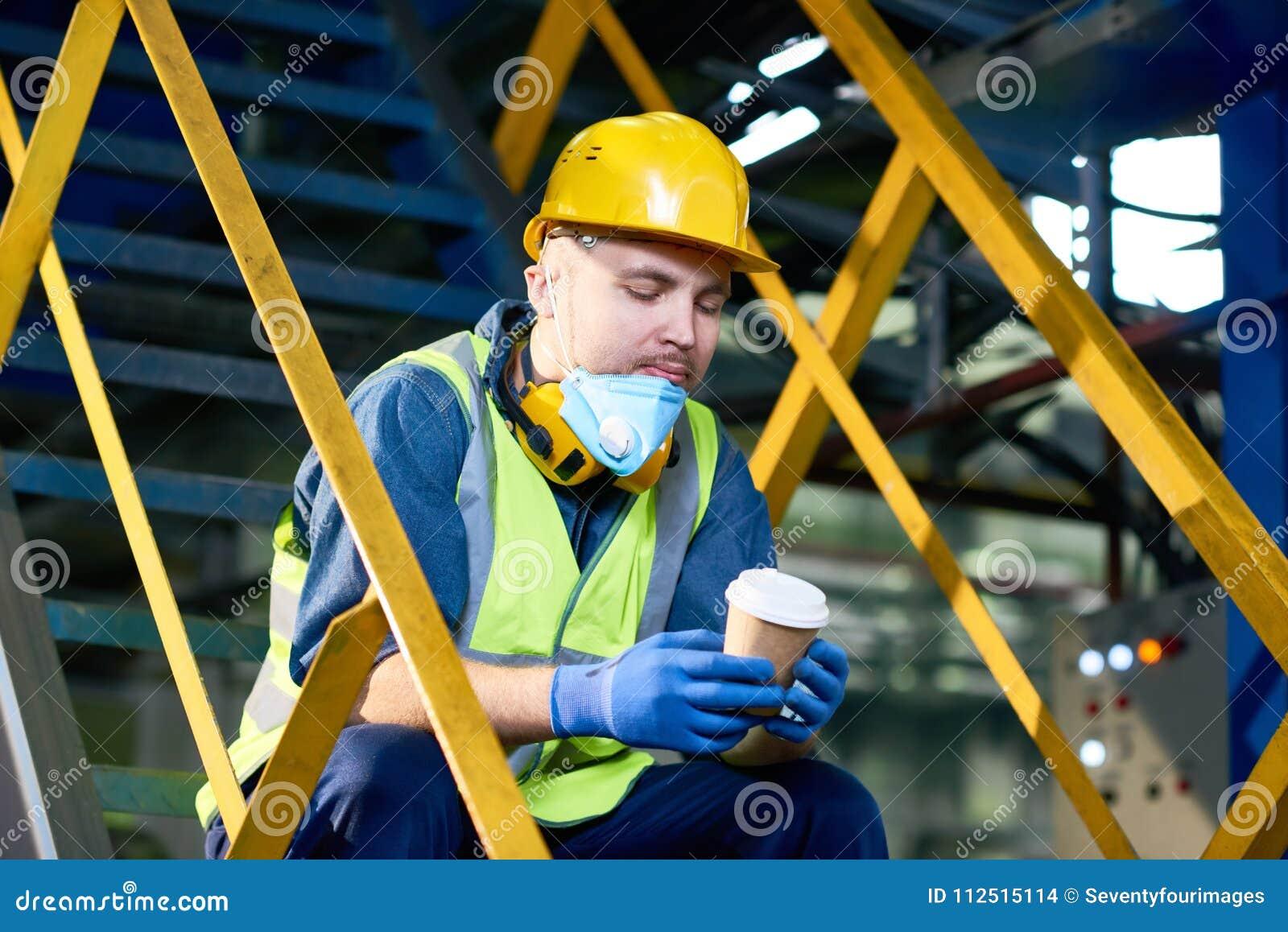 Take Break Coffeebreak : Young man taking coffee break at plant stock photo image of